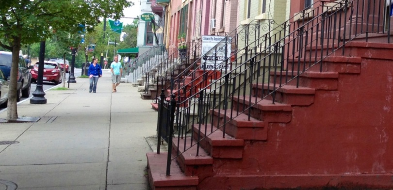 a red stoop on the west side of lark street, between madison & hudson, albany, ny